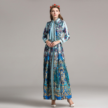 Europe station 2018 early spring womens wear new line of dress with a bow floral print holiday dress.