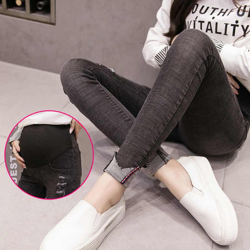 Jeansy ciążowe dla kobiet w ciąży ciąża ciepłe zimowe dżinsy spodnie odzież ciążowa karmienie Prop Belly Legging dziewiątego spodnie