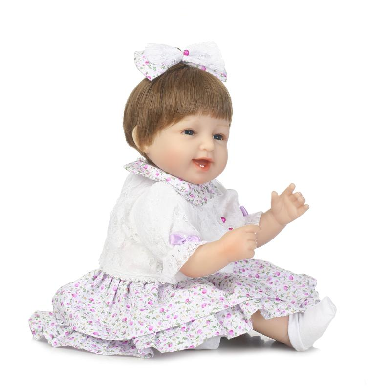 NPKCOLLECTION simulation reborn baby doll soft vinyl silicone touch smile girl doll holiday gift toys for children on Christmas