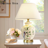 High end custom made American style painted ceramic desk lamp bedroom bedside lamp the latest flower bird decorative desk lamp
