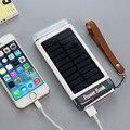 DCAE New Travel Impermeable Solar Banco de la Energía 10000 mah Dual USB powerbank cargador de batería solar con luz led para iphone 6 xiaomi