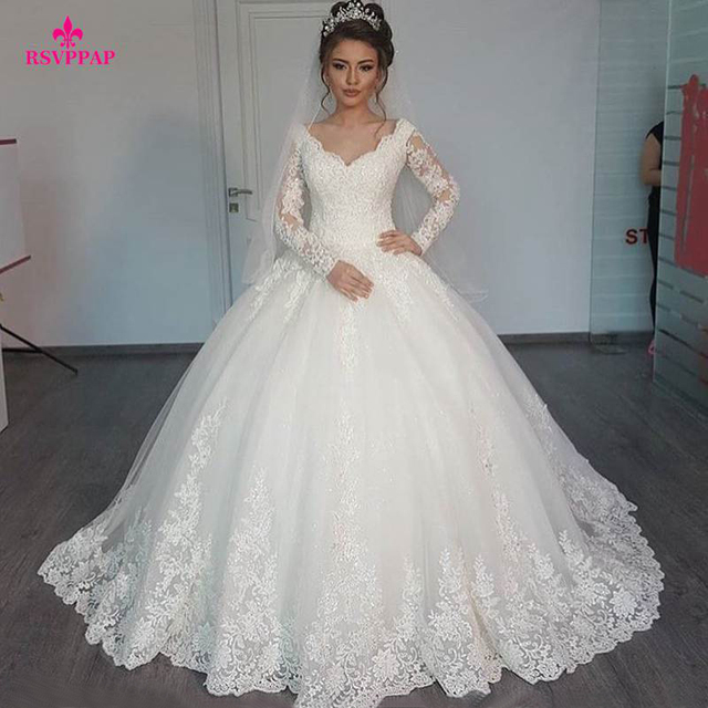 Gorgeous Sheer Ball Gown Wedding Dresses 2017 Puffy Lace Beaded Applique White Long Sleeve Arab