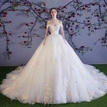 Robe de mariée en dentelle avec fleur