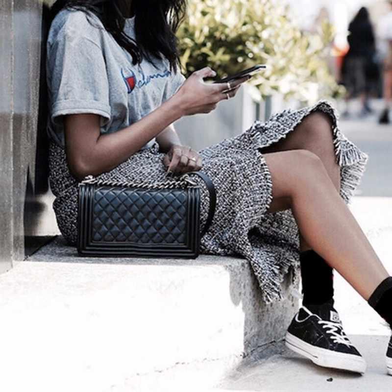 TWOTWINSTYLE клетчатая юбка Женская Лоскутная с кисточками Высокая талия Сплит Нерегулярные миди юбки Весенняя мода Винтаж 2019 одежда