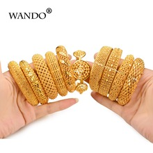 Купить с кэшбэком WANDO New Style Hollow Pattern Hot Bracelet Flower Cuff Bracelets Gold Color Wholesale Vintage Ethnic Jewelry For Women Gift