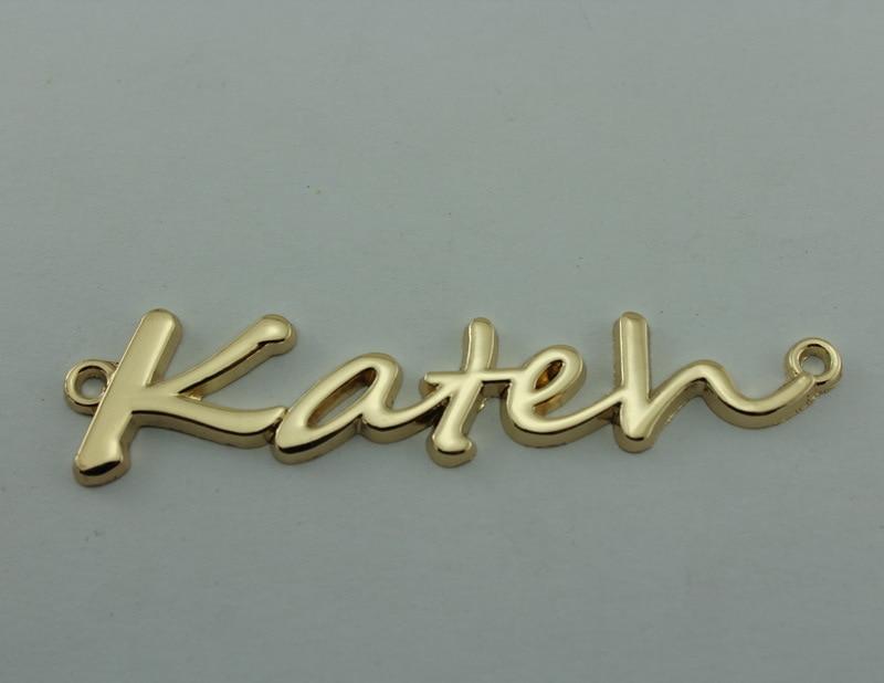 freies Verschiffen (100 PC / Satz) englische Buchstabenmetallaufkleber, goldenes eletroplating Kleidungsetikett mit kundenspezifischem Markenlogo