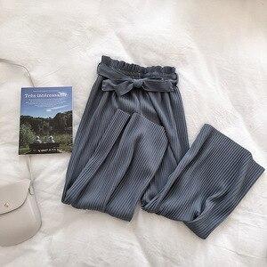 Image 4 - YuooMuoo lato elegancki styl regularne spodnie do kostek szerokie nogawki solidne plisowane spodnie wiosna wysokiej talii paski spodnie ściągane sznurkiem