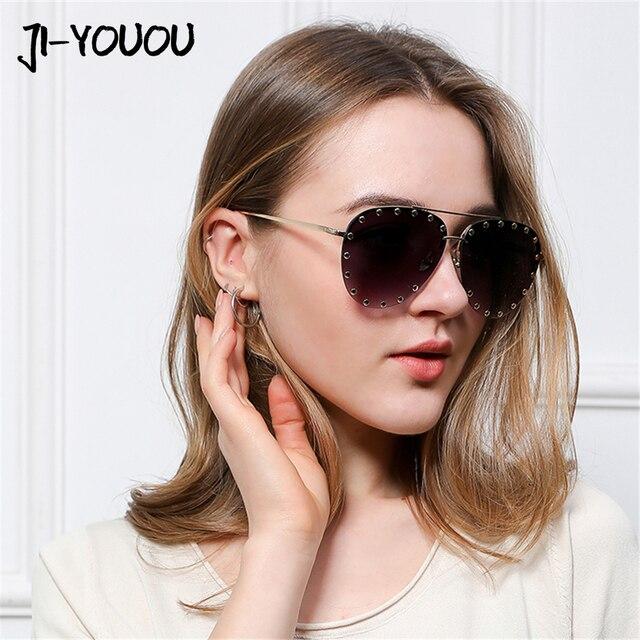 JIYOUOU 2018 nuevas gafas de sol del marco del Metal moda remaches hombres mujeres  moda calle 943d0c6c4c19