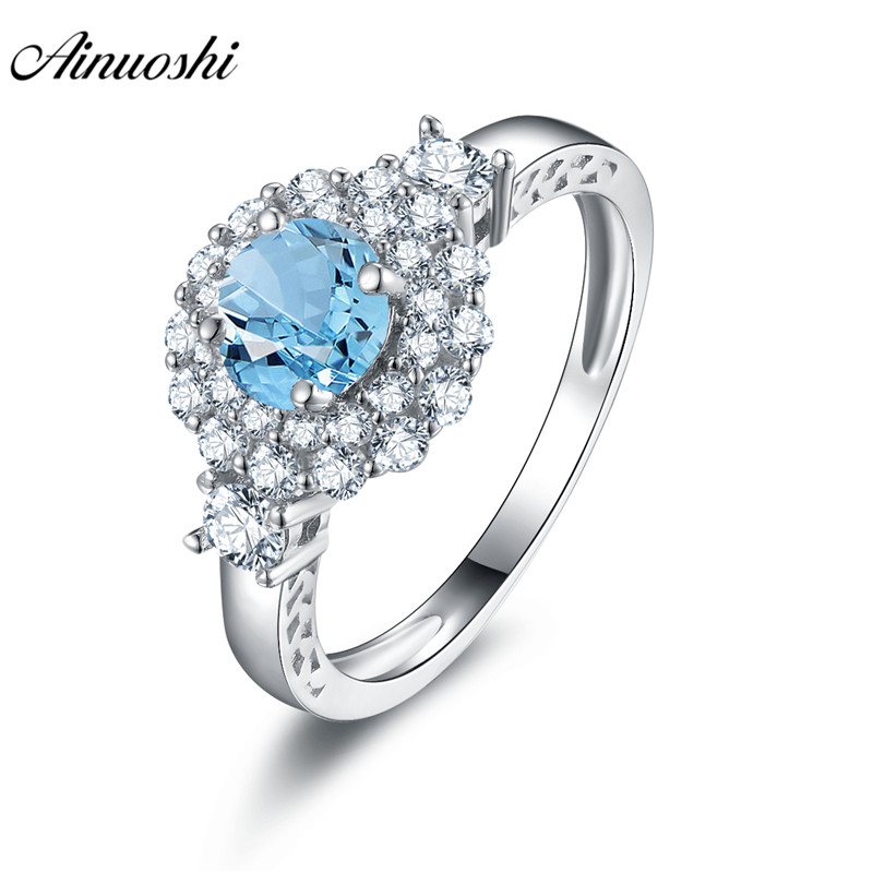 AINUOSHI Blue Natural Topaz Halo Ring 0.63ct Round Cut Gemstone Engagement Wedding Ring 925 Sterling Silver Jewelry Women RingAINUOSHI Blue Natural Topaz Halo Ring 0.63ct Round Cut Gemstone Engagement Wedding Ring 925 Sterling Silver Jewelry Women Ring