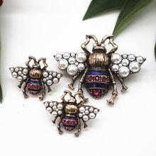 b92041a7bb7f Esmalte de la aleación de la vendimia imitación perla insecto broche señora  925 pendientes de plata broche pareja Set regalo de .