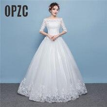 صور حقيقية على شكل قلب a خط أبيض أحمر موضة فاخر يزين فستان الزفاف الدانتيل الخلفي تصميم مثير قارب الرقبة نمط الوهم