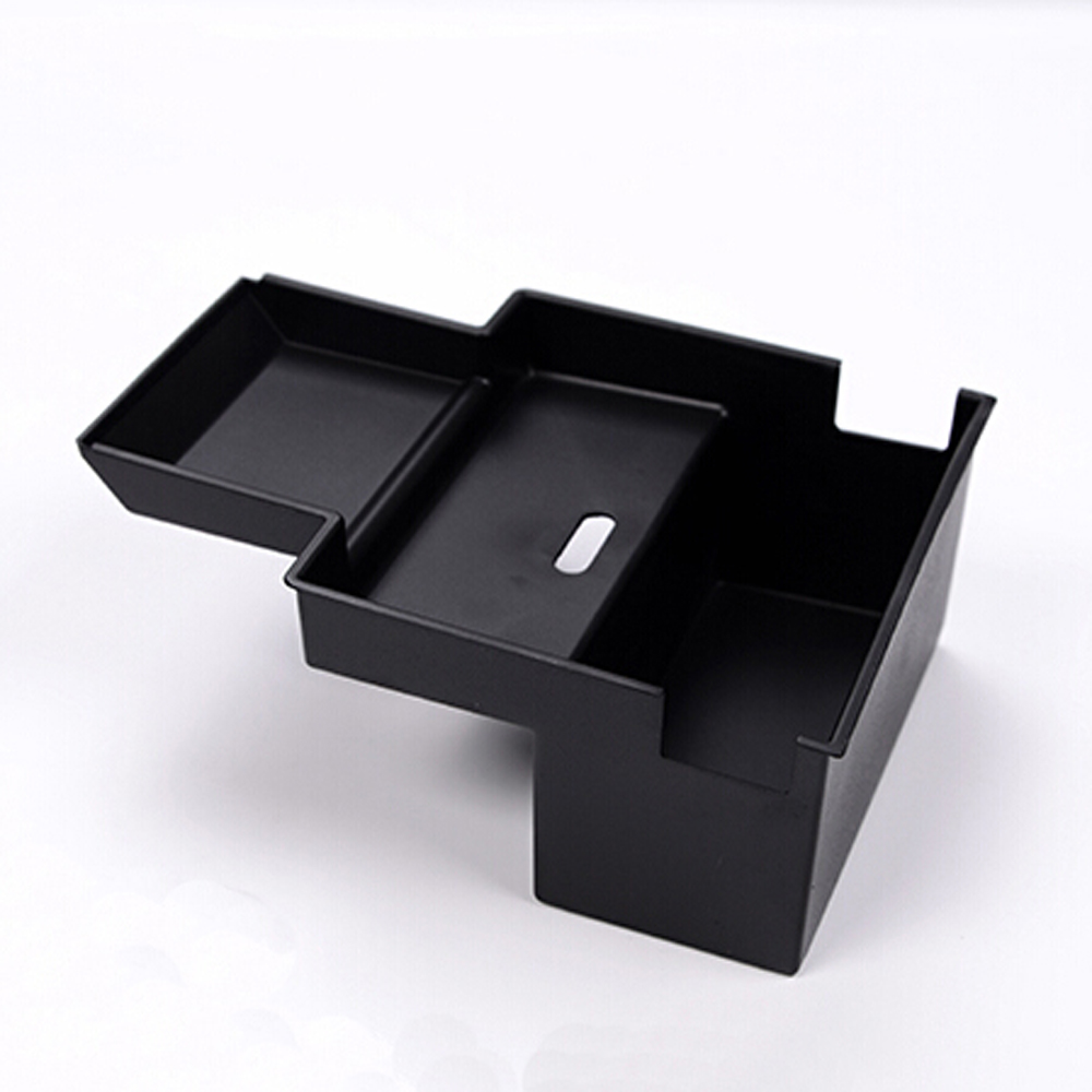 stowing tidying central armrest compartment tray storage. Black Bedroom Furniture Sets. Home Design Ideas