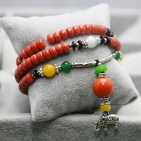 Leisure time Lucky Wax Beads Orange Bracelet Tibet Silver hand chain for women girls Ladies Pendant Tassels jewelry design