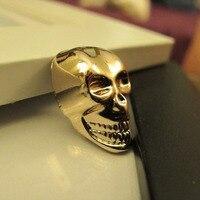 Nuevo 12 unids lot oro brillante 3D camisa de vestir botón vástago de metal la cabeza del cráneo esqueleto decorativo ornamento accesorios envío gratis
