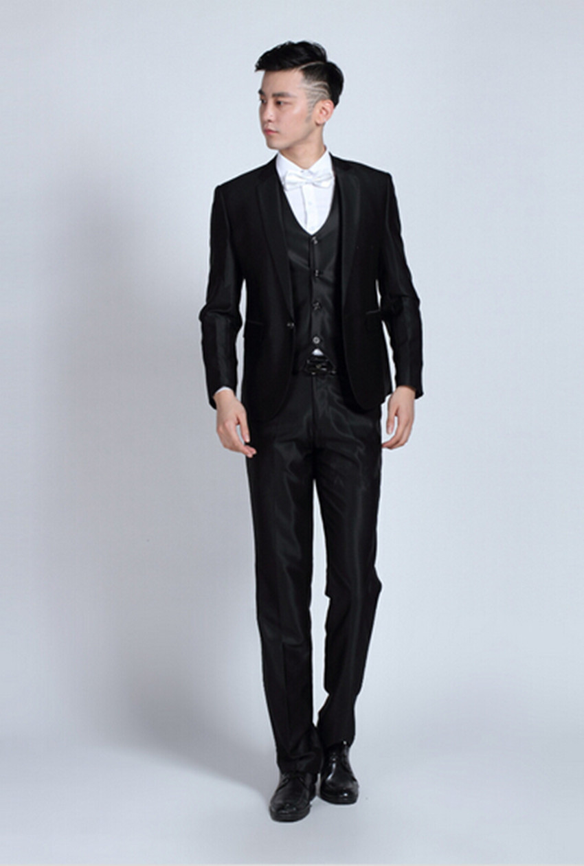 Wedding fashion of shiny black suit jacket pants gentleman man is