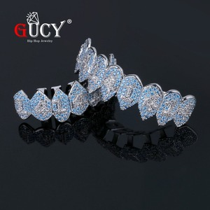 Image 1 - GUCY Iced Out Hip Hop 1414 Teeth Grillz Bling AAA Cubic Zircon Silver Color Eight Top & Bottom Vampire  Grills Set For Gift