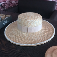 Ins spring, summer, red net AM same niche aristocratic demeanor fake hat eaves heavy flat-topped big pearl straw hat Sun Hats