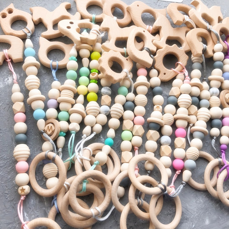 Купить с кэшбэком Chenkai 50pcs Wood Teether Ring DIY Organic Eco-friendly Unfinished Nature Infant Baby Pacifier Grasping Sensory Wooden Toy