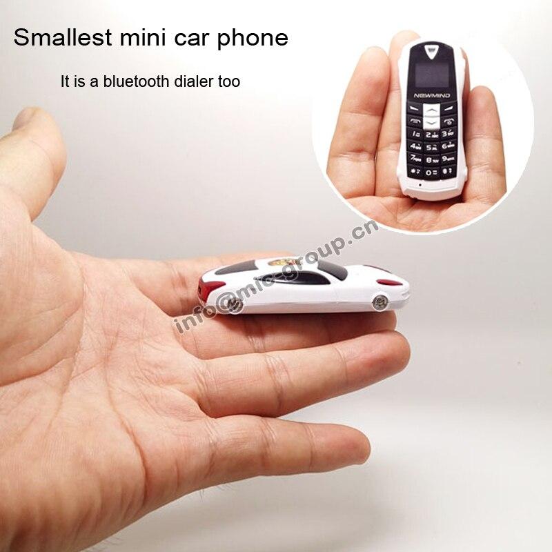 Цена за Newmind F1 Русский, Французский, Испанский меню Кач группа Наименьший мини модель Автомобиля наушники телефона bluetooth dialer MP3 P097