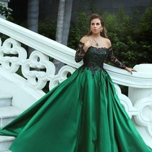 Emerald Green Dubai Evening Dresses With Sparkling Black Appliques Long  Sleeve Ladies Formal Gown Satin Boat fe2ce8807bfb