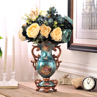 atmosphere of luxury living room TV cabinet table decoration decorative vase floral floral ornaments simulation