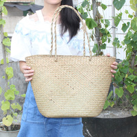 Q Guangzhou IEE Supply Beach Bags Pure Natural Environmental Protection Grass Woven Bag Straw Storage Baskets