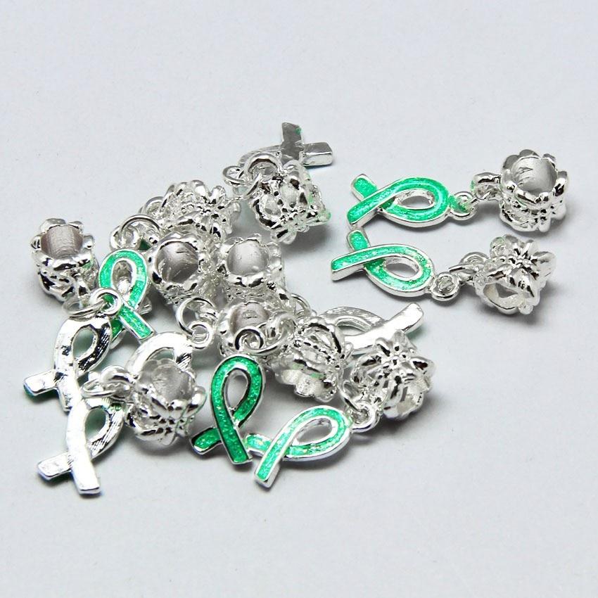 Câncer de Mama Oscila Encantos Fita Verde