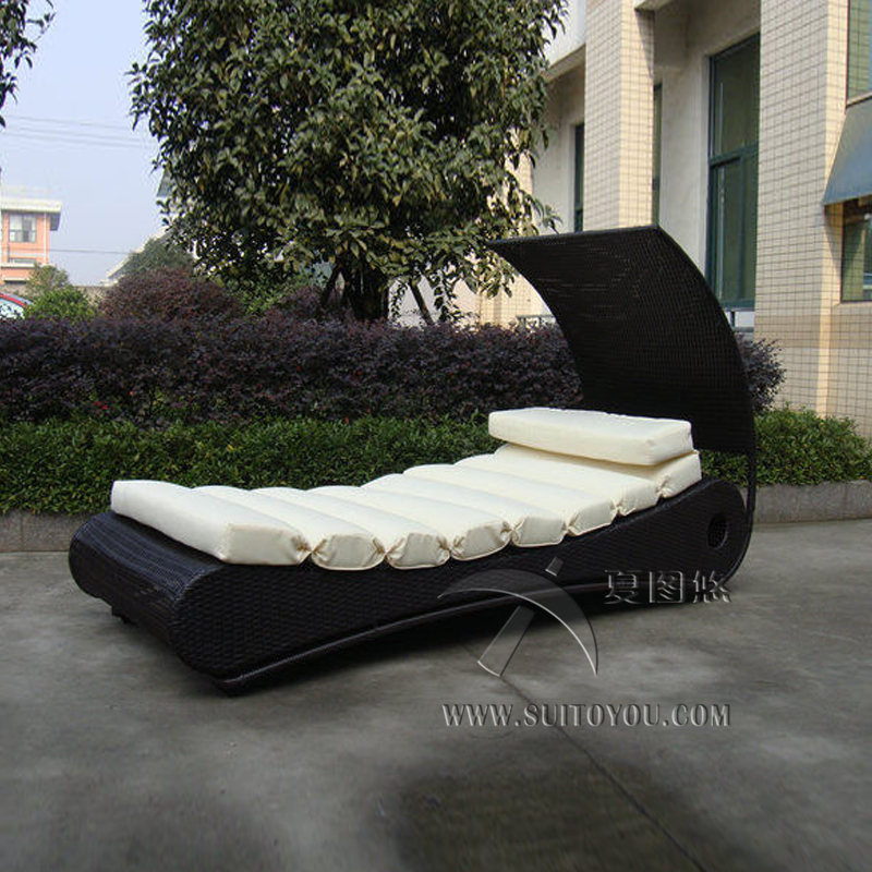 Comfortable Roofed Black Rattan Sun Lounger With White Cushion to sea port by sea
