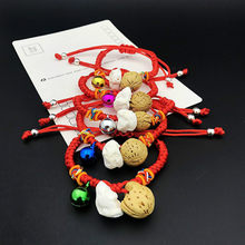 1pcs sell Baby The Newborn Bangles Bracelets The Dog Tooth Peach Pit Bracelets The Bell Red Rope Hand Catenary(China)