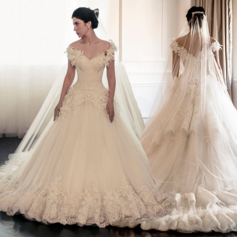 Lace appliques wedding gown cap sleeve a line bridal gowns lace appliques wedding gown cap sleeve a line bridal gowns sweetheart luxury feather wedding dresses newest robe de mariage 2017 in wedding dresses from ombrellifo Choice Image