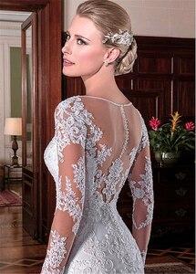 Image 2 - Exquisite Tüll Jewel Ausschnitt Meerjungfrau Hochzeit Kleider Mit Perlen Spitze Applqiques Lange Ärmel Brautkleider