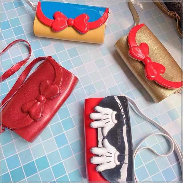 MINI MELISSA เด็กแฟชั่นรองเท้าแตะเด็กการ์ตูนเด็กกระเป๋า 4 สีทอง/สีแดง/สีขาว/สีดำ