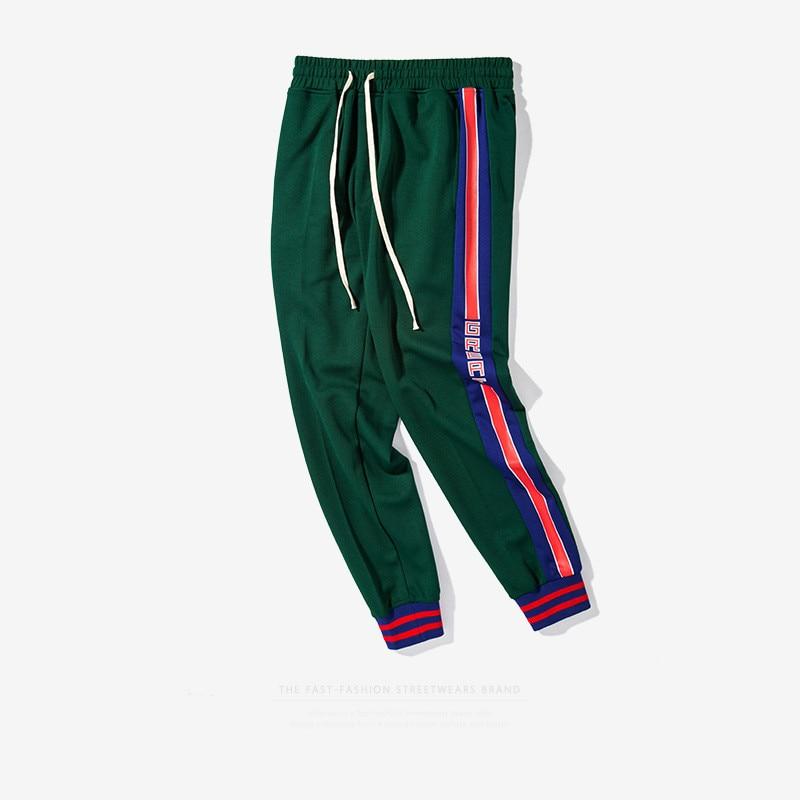 Alta calidad 2017 streetwear Skateboard Pantalones de chándal nueva moda hip  hop Pantalones lado rayas mujeres hombres joggers Pantalones 3 color en ... 2fdb3f420a5