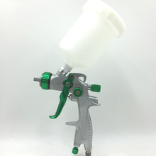 цена на SAT1390B Professional HVLP Air Spray Gun Nozzle 1.4mm Paint Spray 600ml Gravity Feed Airbrush Kit Car Furniture Paint Gun