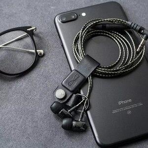Image 3 - חם מקורי Bcase MEC מגנטי אוזניות קליפ שלושה צבעים עור אבזם אוזניות חוט ארגונית מחזיק נייד כבל