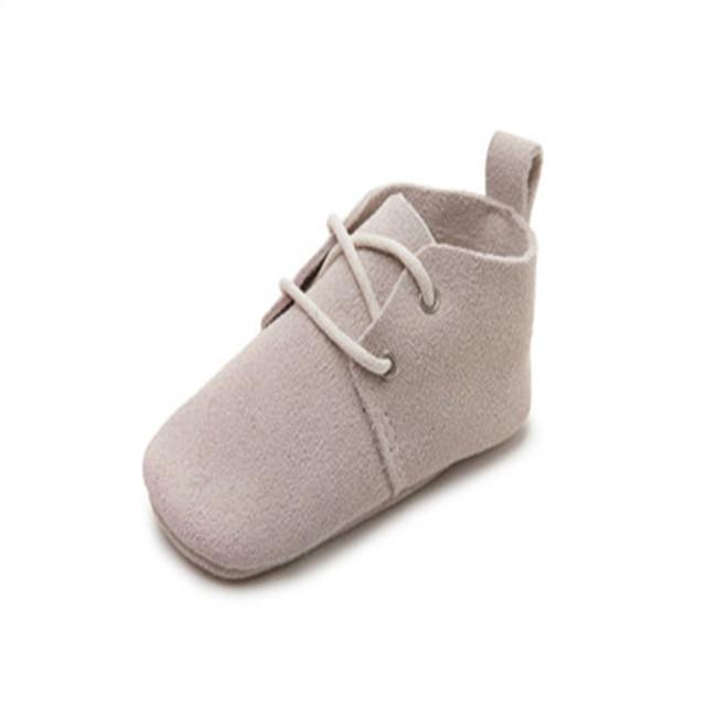 Comercio al por mayor 9 Colores de La Nueva Manera Suave Único Bebés Niñas niños Toddler Primeros Caminante Recién Nacido Con Cordones Mocasines de Cuero Genuino zapatos