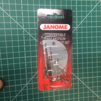 JANOME MULTIFUNCTIONAL HOUSEHOLD SEWING MACHINE PARTS # 767433004 EMBROIDERY PRESSER FOOT AND NEEDLE PLATE PACKAGE