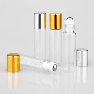 Image 4 - Toptan 100 adet/grup Mini cam parfüm şişeleri üzerinde rulo ile boş kozmetik uçucu yağ seyahat için çelik top ile şişe