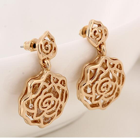 2016 Fashion jewelry golden flower earrings pierced earrings met Zircon Rose sliver stud earrings Wholesale Free shipping