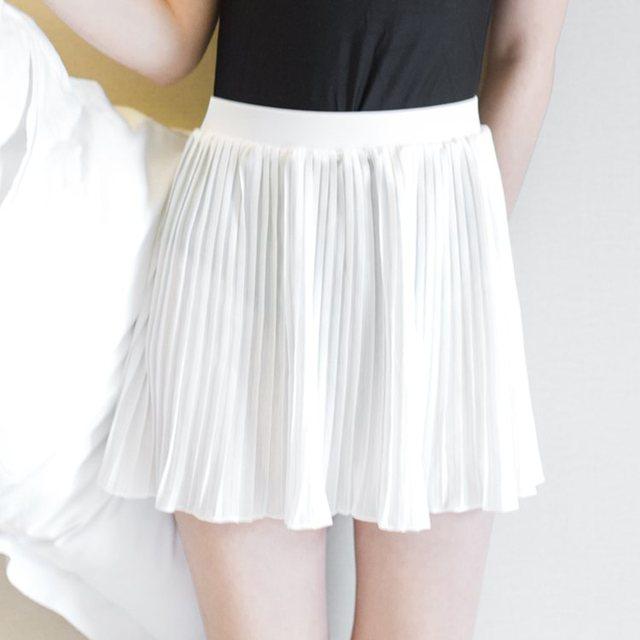 Falda corta de gasa blanca media falda primavera y verano Falda plisada  buena colocación con traje abe08e73a1ad