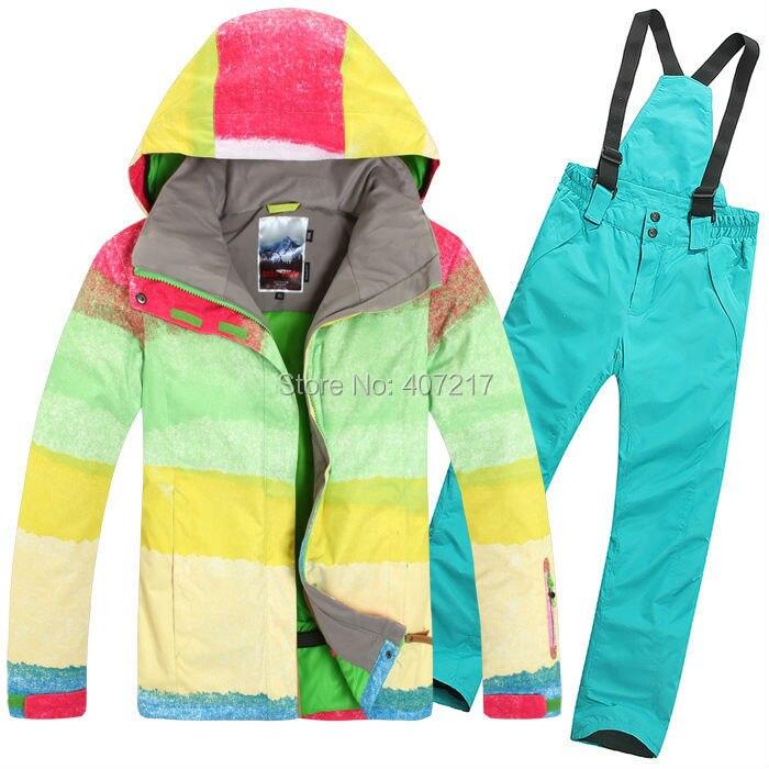 Prix pour 2015 femmes bleu combinaison de ski féminin snowboard vêtements de ski Couleur correspondant grille ski veste et bleu bretelle pantalon de ski imperméable