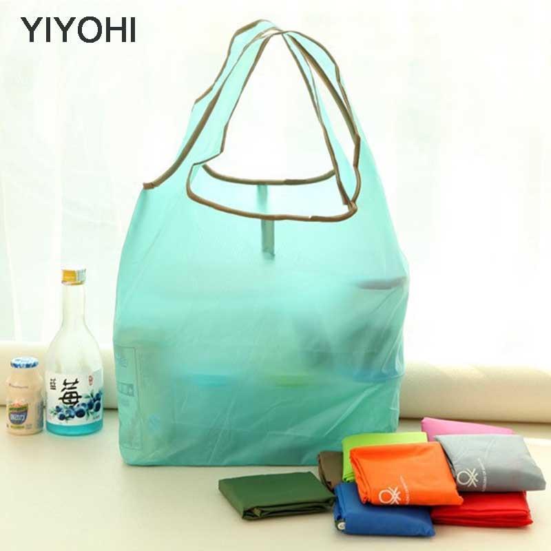купить YIYOHI Candy Color New printing foldable green shopping bag Tote Folding pouch handbags Convenient Large-capacity storage bags по цене 114.92 рублей