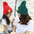 2016 Winter Smile face Child knitted hat kids girls Pointy hats Highly elastic solid Parent-child hat