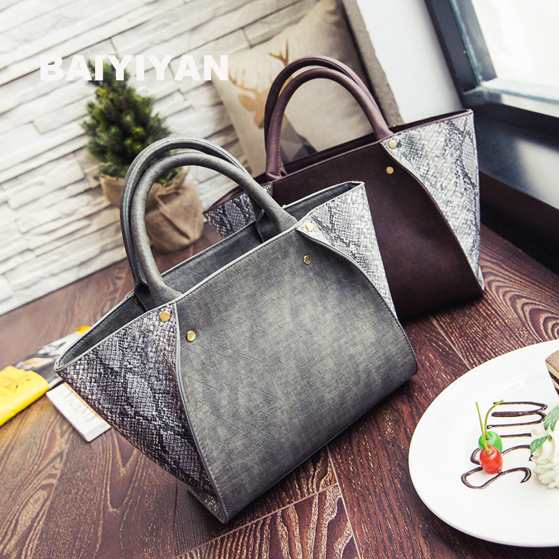 2016 New Winter Hit Color Fashion Trend Snakeskin Pattern Handbag Handbag Wings Shoulder Bag Diagonal Package