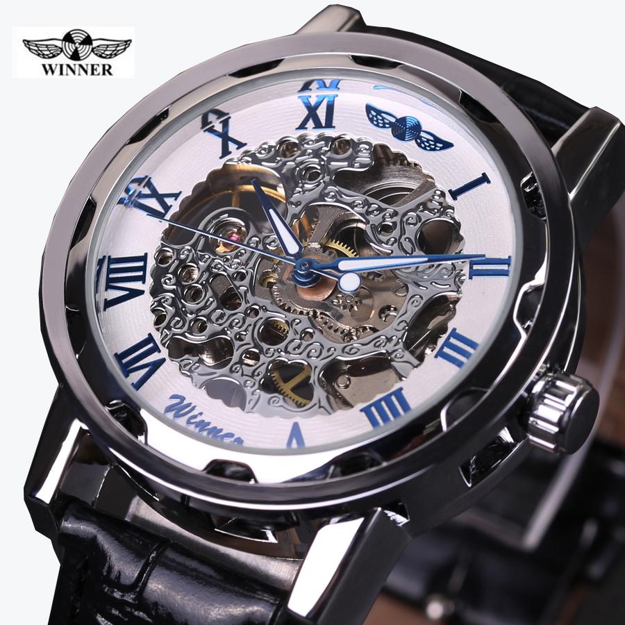 Prix pour 2016 GAGNANT creux mécanique main-vent hommes femmes montres classique sculpture squelette cadran en or véritable bracelet en cuir montre-bracelet