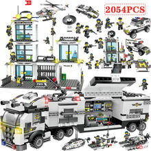 2054pcs Building Blocks Police Station SWAT Figures Compatible Legoing City Enlighten Bricks Toys For Children Truck Helicopter(China)