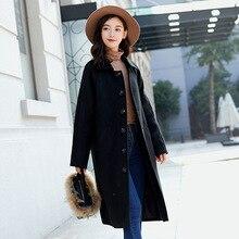6b1cf7749 El nuevo paño de lana abrigo mujer 2018 de tela de moda abrigo de solapa  color puro de tela