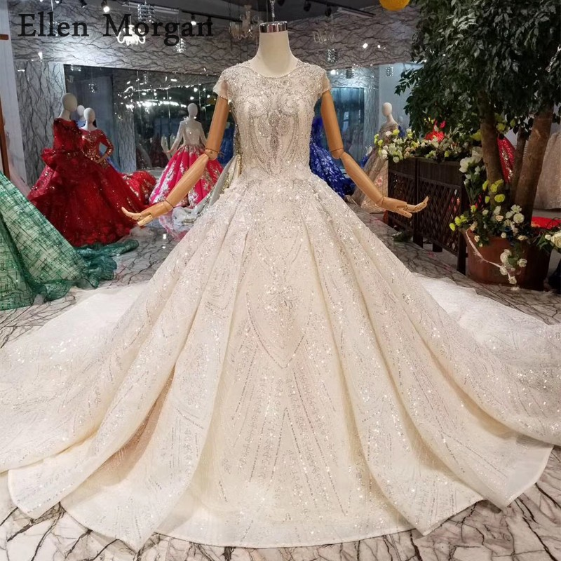 Elegant Lace Ball Gowns Wedding Dresses 2019 Beaded Corset Boat Neck Cap Sleeves Glitter Backless Luxury Bridal Gowns For Women