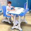 De chico, mesa de estudio ergonómico de los niños tarea escritorio estudiante ajustable escritorio y silla de combinación
