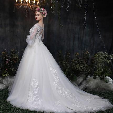d3c49c44cc429 2019 New White Wedding Dress Long Tail Princess Flower Decoration Bride  Wedding Dress